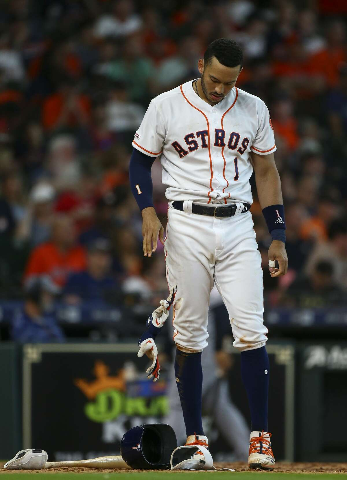 Houston Astros shortstop Carlos Correa (1) reacts after striking out against the Cleveland Indians during the eighth inning of an MLB game at Minute Maid Park Saturday, April 27, 2019, in Houston.