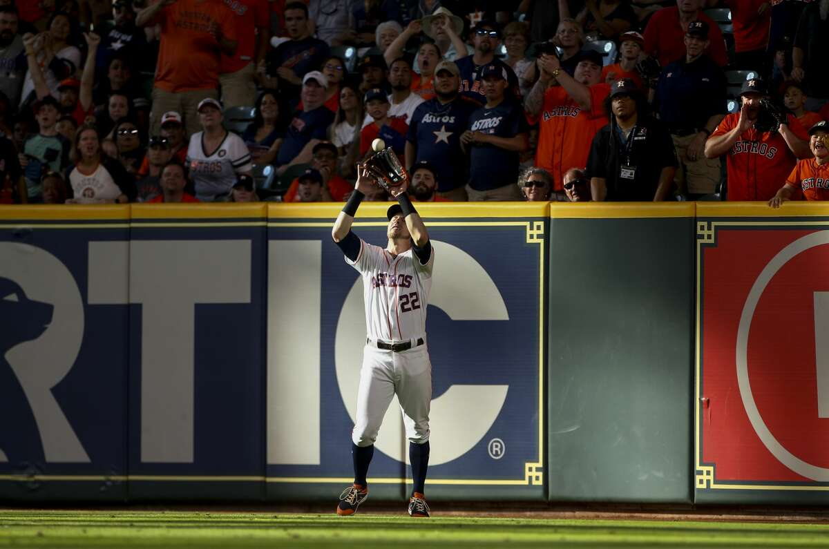 Houston Astros right fielder Josh Reddick (22) makes a catch for the third out against the Cleveland Indians during the 10th inning of an MLB game at Minute Maid Park Saturday, April 27, 2019, in Houston.