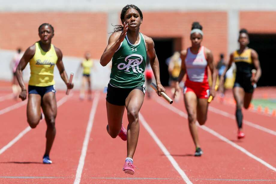 Reagan's Jasmine Montgomery, second from left, approaches the finish line of the 6A girls 400-meter relay during the second day of the Region IV-6A/5A track and field meet at Heroes Stadium on Saturday, April 27, 2019. Reagan won the event with a time of 46.32 seconds. Montgomery also broke the regional record she set the day before in the 100-meter dash and took first first place in the 200. Photo: Marvin Pfeiffer, Staff Photographer / Express-News 2019