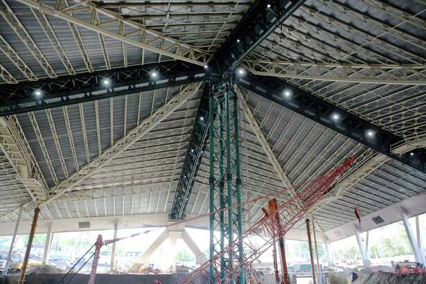 Construction continues on the new arena at Seattle Center, Monday, Sept. 16, 2019. The 44-million pound roof of the arena is suspended by a central scaffolding as the new arena is built underneath.