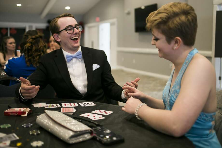 Coleman High School senior Angelie Balliet, right, plays Go Fish with her guest, Weston Smith, left, during Coleman's prom at PohlCat Golf Course in Mount Pleasant on Saturday, April 27, 2019. (Katy Kildee/kkildee@mdn.net) Photo: (Katy Kildee/kkildee@mdn.net)