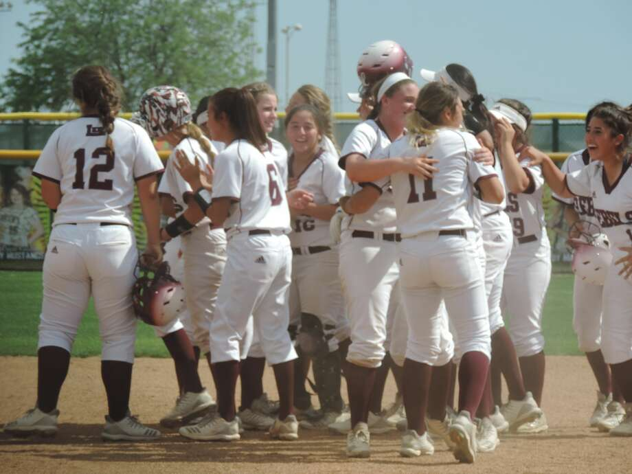 The Lee softball team celebrates after beating El Paso Americas, 4-3, in Game 3 to take the Class 6A bi-district playoff series, Saturday at Andrews softball field. Christopher Hadorn MRT Photo: Christopher Hadorn