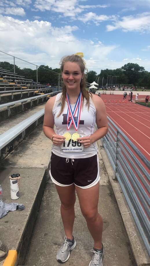 Lee junior track & field athlete Paige Low poses with her two gold medals at the Region I-6A in Arlington on Saturday. Low qualified for state in both the shot put and discus. Photo: Courtesy Photo
