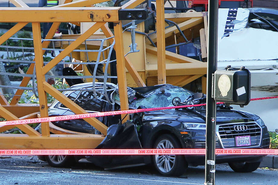 A crane working on a future Google building at the corner of Mercer Street and Fairview Avenue N collapsed, Saturday afternoon, killing four people and injuring four others, April 27, 2019. Two of the casualties were ironworkers and two were in cars moving down Mercer. Photo: Genna Martin, SEATTLEPI / GENNA MARTIN