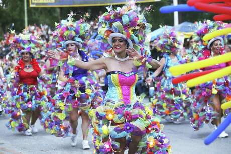 Las Charangas dancers move down Broadway in the Fiesta Flambeau Parade on April 27, 2019.