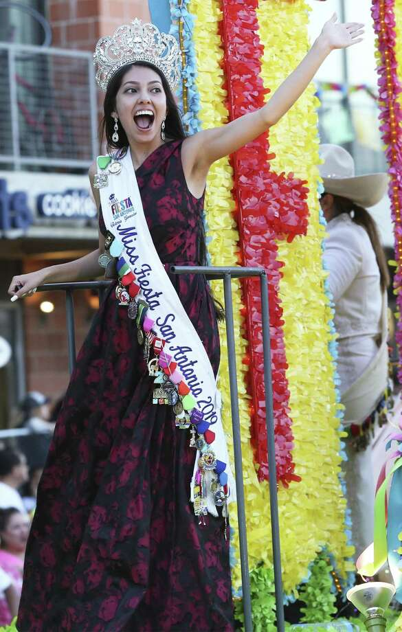 Miss Fiesta responds to cheers during the Fiesta Flambeau Parade on April 27, 2019. Photo: Tom Reel, Staff / Staff Photographer / 2019 SAN ANTONIO EXPRESS-NEWS