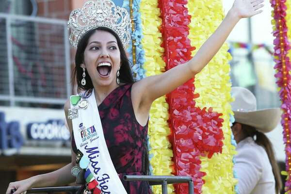 Miss Fiesta responds to cheers during the Fiesta Flambeau Parade on April 27, 2019.