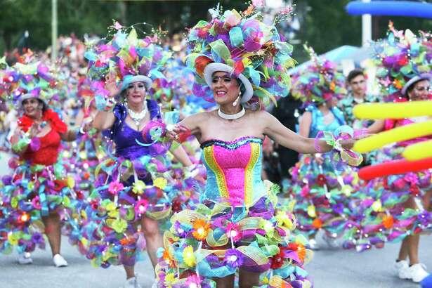 Las Charangas dancers move down Broadway in the Fiesta Flambeau Parade last year.