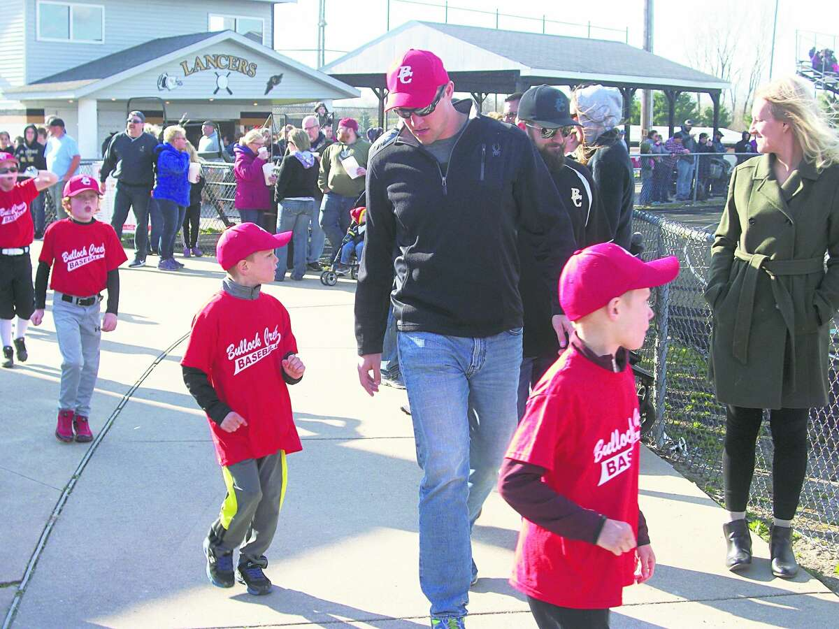 Players march during opening ceremonies for Bullock Creek Little League at Bullock Creek High School onFriday, April26, 2019.In its third season,BCLL has 360 players on 42 teams and more than 50 sponsors.