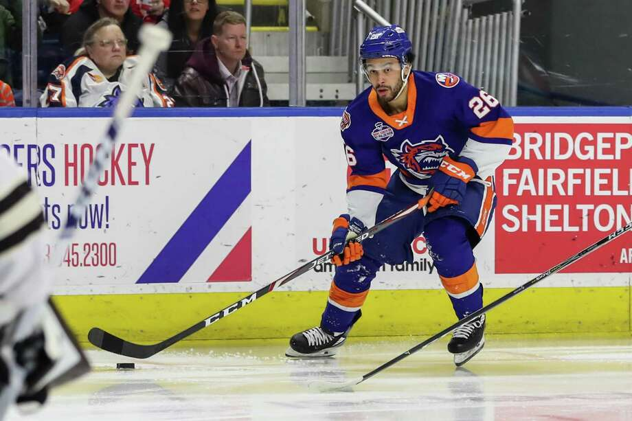 Joshua Ho-Sang (26) of the Bridgeport Sound Tigers carries the puck during game five of round one in the AHL Calder Cup Playoffs between the Bridgeport Sound Tigers and the Hershey Bears on April 27, 2019 at the Webster Bank Arena in Bridgeport, CT. Photo: John McCreary / For Hearst Connecticut Media / Connecticut Post Freelance