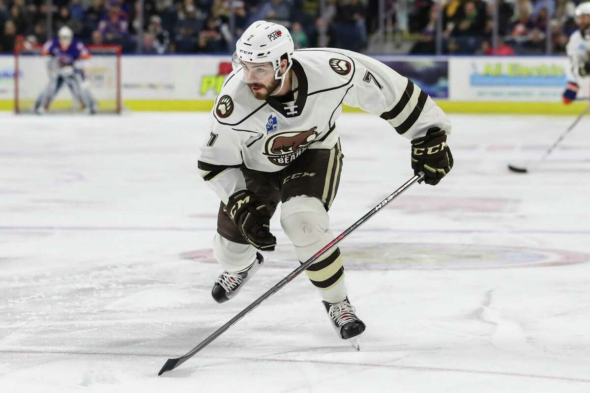 Connor Hobbs (7) of the Hershey Bears chases down a loose puck during game five of round one in the AHL Calder Cup Playoffs between the Bridgeport Sound Tigers and the Hershey Bears on April 27, 2019 at the Webster Bank Arena in Bridgeport, CT.