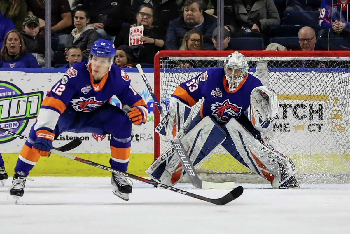 Christopher Gibson (33) of the Bridgeport Sound Tigers looks around traffic to find the puck during play during game five of round one in the AHL Calder Cup Playoffs between the Bridgeport Sound Tigers and the Hershey Bears on April 27, 2019 at the Webster Bank Arena in Bridgeport, CT.