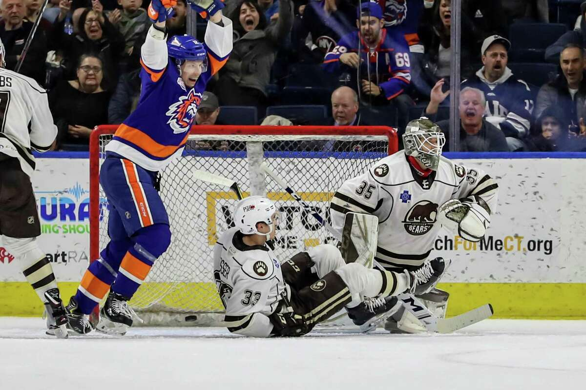 Otto Koivula (12) of the Bridgeport Sound Tigers celebrates a second period goal by Oliver Wahlstrom (38, Not Pictured) during game five of round one in the AHL Calder Cup Playoffs between the Bridgeport Sound Tigers and the Hershey Bears on April 27, 2019 at the Webster Bank Arena in Bridgeport, CT.