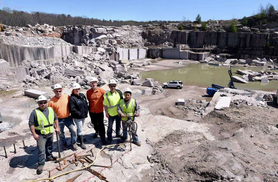 From left, Guido Lopez, quarry supervisor Rick Atkinson, Stacy Bandecchi, Darrell Petit, Rodrigo Vega and Manuel Pugo are photographed at the Stony Creek Quarry in Branford on April 23. Photo: Arnold Gold / Hearst Connecticut Media / New Haven Register