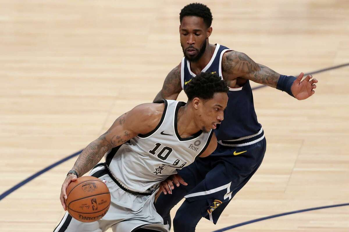 DENVER, COLORADO - APRIL 27: Demar Derozan #10 of the San Antonio Spurs drives against Will Barton of the Denver Nuggets in the second quarter during Game Seven of the first round of the 2019 NBA Western Conference Playoffs at the Pepsi Center on April 27, 2019 in Denver, Colorado.