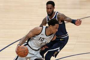 DENVER, COLORADO - APRIL 27: Demar Derozan #10 of the San Antonio Spurs drives against Will Barton of the Denver Nuggets in the second quarter during Game Seven of the first round of the 2019 NBA Western Conference Playoffs at the Pepsi Center on April 27, 2019 in Denver, Colorado. NOTE TO USER: User expressly acknowledges and agrees that, by downloading and or using this photograph, User is consenting to the terms and conditions of the Getty Images License Agreement.