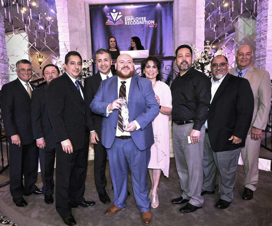 Juarez-Lincoln Elementary School's Robert Valdez Jr., front and center, poses with his UISD Elementary Educator of the Year for 2019 award. Photo: Courtesy