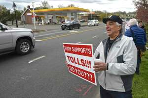 Joe Savino, of Ridgefield, takes part in a No Tolls Ct protest in front of Copps Hill Plaza, on Danbury Road, in Ridgefield, Conn., Saturday morning, April 27, 2019.