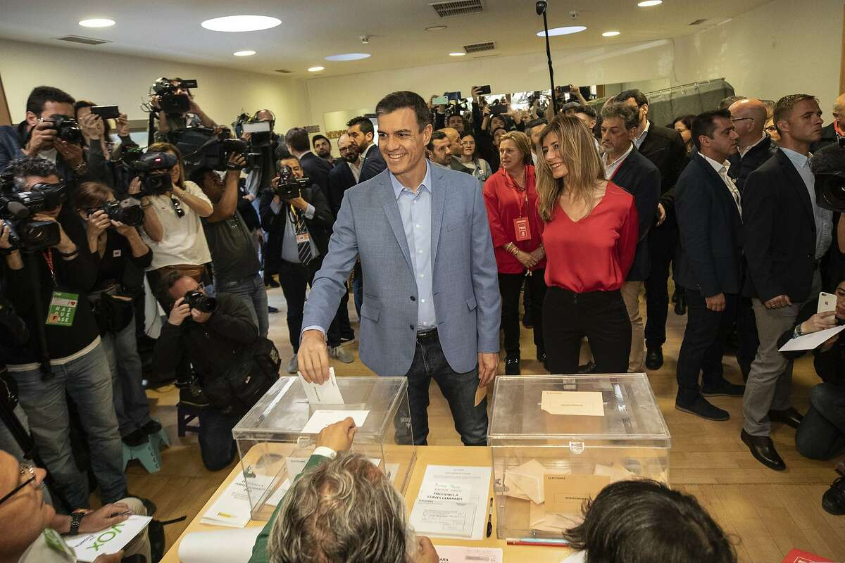Spanish Prime Minister and Socialist Party candidate Pedro Sanchez casts his vote inside a polling station during Spain's general election in Pozuelo de Alarcon, outskirts of Madrid, Sunday, April 28, 2019. An uncertain outcome and the likelihood of the far right erupting into Spain's Parliament looms over national elections on Sunday, when nearly 37 million Spaniards are called to cast ballots in the most highly polarized election in decades. (AP Photo/Bernat Armangue)