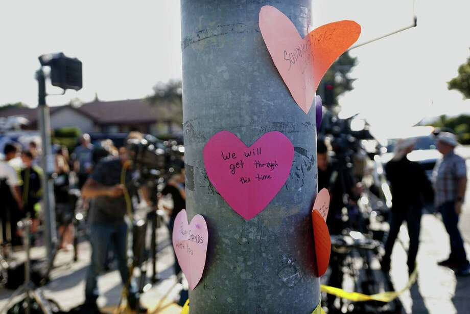 Hand-written notes are displayed on a light post across the street from the Chabad of Poway Synagogue after a shooting on Saturday in Poway, Calif. Photo: SANDY HUFFAKER / AFP /Getty Images / AFP or licensors