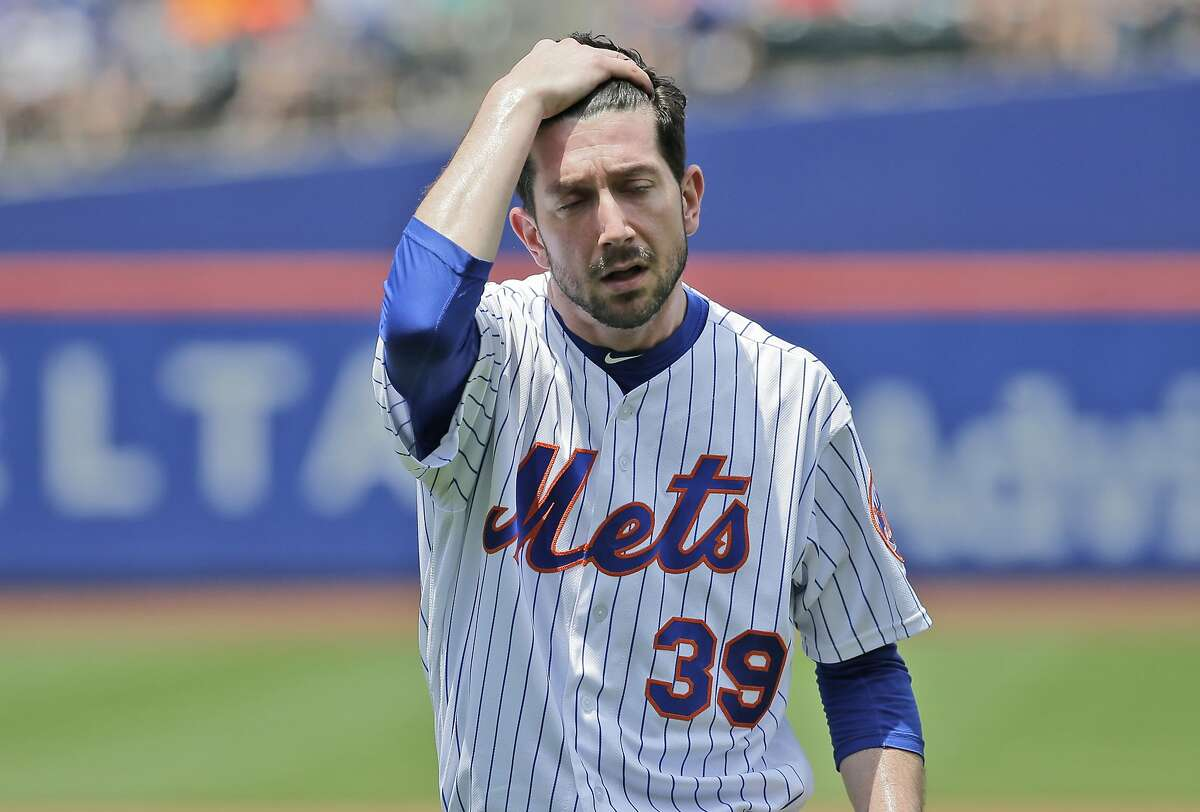 FILE - In this June 24, 2018, file photo, New York Mets pitcher Jerry Blevins leaves the field after the top of the first inning of a baseball game against the Los Angeles Dodgers, at Citi Field in New York. With the Mets sinking fast toward the bottom of the National League standings, baseball operations were turned over Tuesday, June 26, to a trio of Sandy Alderson's assistants as the 70-year-old general manager made the stunning announcement that he was stepping down because his cancer has returned. (AP Photo/Seth Wenig, File)