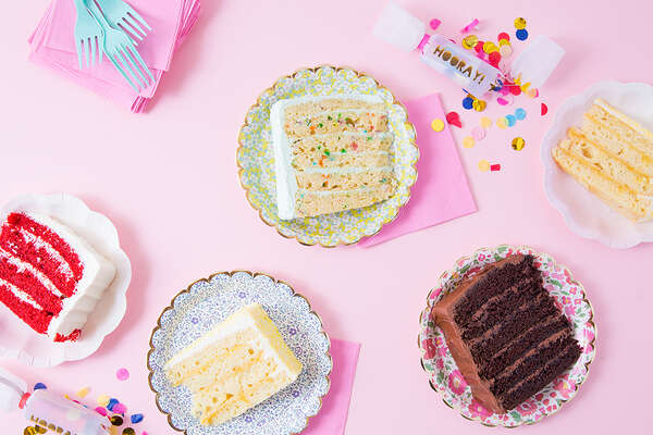 Slices of the specialty layer cakes at SusieCakes.