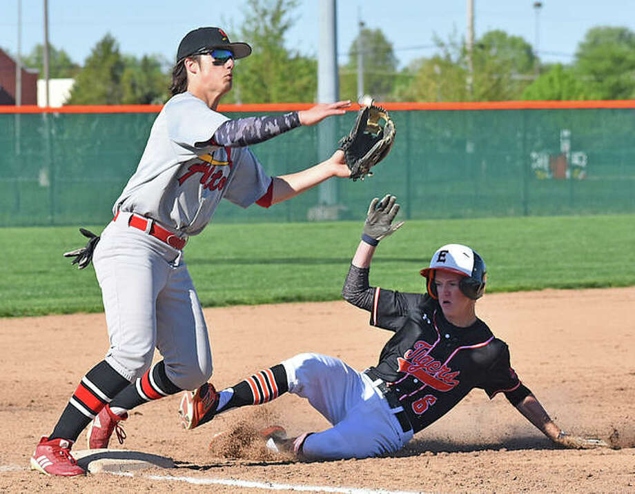 Edwardsville's Hayden Moore slides under the tag of the Alton third baseman on Friday afternoon at Tom Pile Field. The Tigers also played Friday night against Civic Memorial. Photo: Associated Press