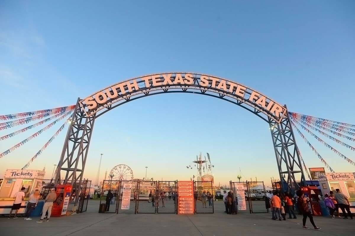 Fair goers make their way into the entry on the opening night of the YMBL South Texas State Fair at Ford Park. Photo taken Thursday, March 21, 2019 Kim Brent/The Enterprise