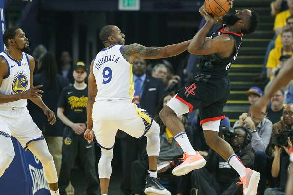 82ee28ba70b3 2of2Golden State Warriors Andre Iguodala fouls Houston Rockets James Harden  in the first quarter during game 1 of the Western Conference Semifinals  between ...