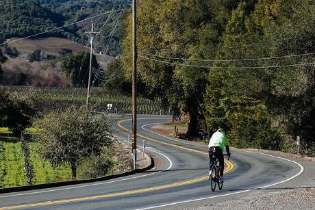A biker makes his way down West Dry Creek Road in Healdsburg, Calif. Saturday, Jan. 6, 2018.
