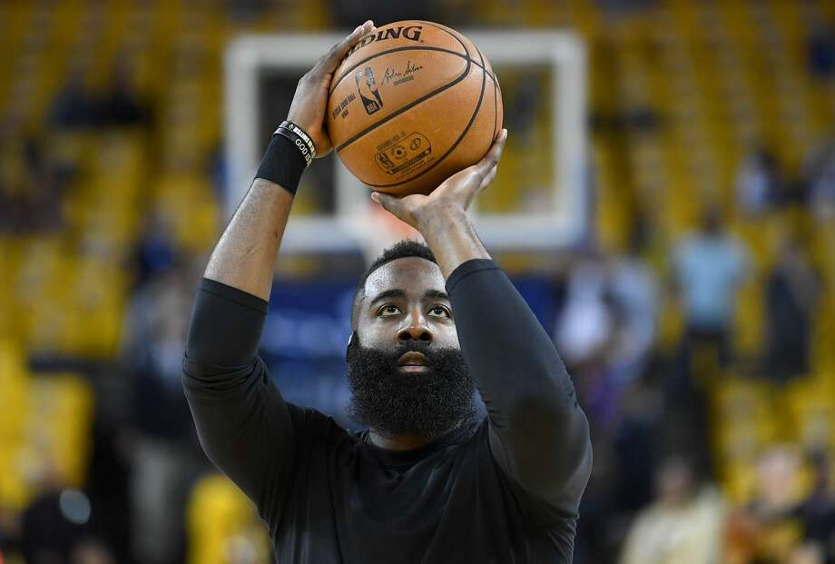 James Harden #13 of the Houston Rockets warms up prior to playing the Golden State Warriors in Game One of the Second Round of the 2019 NBA Western Conference Playoffs at Oracle Arena on April 28, 2019 in Oakland, California.  Before this photo was taken, Harden was wearing a multicolored bandana quilt outfit while walking into Oracle Arena for Game 1 of the Western Conference semifinals agains the Golden State Warriors. See what basketball fans had to say about the outfit by swiping or clicking through. >>> Photo: Thearon W. Henderson/Getty Images