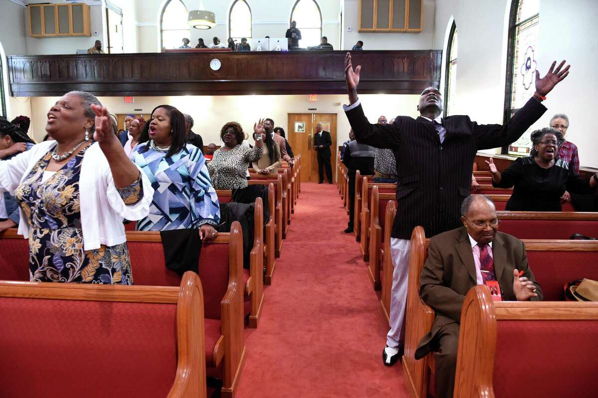 Parishioners pray during the Hope for Healing Community Prayer Service at Varick Memorial AME Zion Church in New Haven on April 28, 2019.