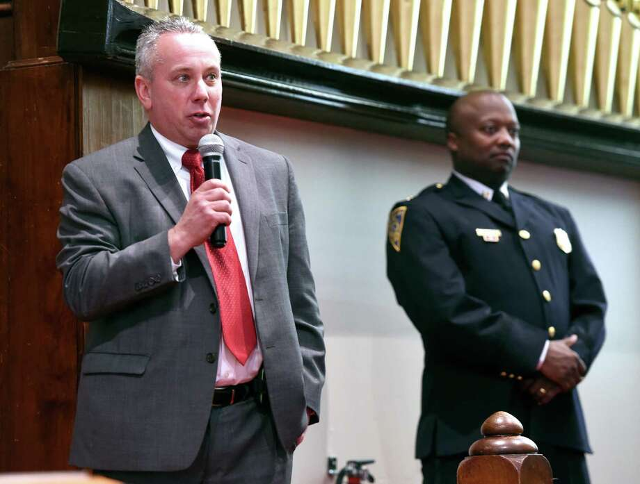 New Haven Police Capt. Anthony Duff, right, with Hamden Acting Police Chief John Cappiello at the Hope for Healing Community Prayer Service at Varick Memorial AME Zion Church in New Haven on April 28. Photo: Arnold Gold / Hearst Connecticut Media / New Haven Register