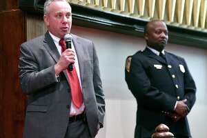 New Haven Police Capt. Anthony Duff, right, with Hamden Acting Police Chief John Cappiello at the Hope for Healing Community Prayer Service at Varick Memorial AME Zion Church in New Haven on April 28.