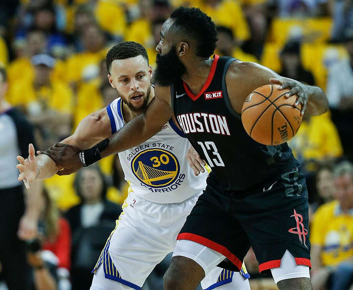 Golden State Warriors Stephen Curry guards Houston Rockets James Harden in the second quarter during game 1 of the Western Conference Semifinals between the Golden State Warriors and the Houston Rockets at Oracle Arena on Sunday, April 28, 2019 in Oakland, Calif.