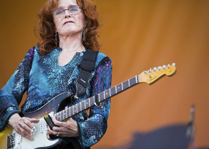 Bonnie Raitt performs on the Acura Stage during the tribute to Dave Bartholomew and Fats Domino at the New Orleans Jazz & Heritage Festival in New Orleans, Sunday, April 28, 2019. (AP Photo/Sophia Germer)