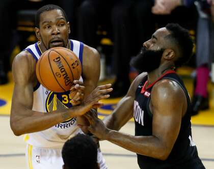 83267b5a4682 Golden State Warriors Kevin Durant loses the ball while guarded by Houston  Rockets James Harden in the third quarter during game 1 of the Western  Conference ...