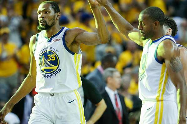 Golden State Warriors Kevin Durant gets a high five from Andre Iguodala in the third quarter during game 1 of the Western Conference Semifinals between the Golden State Warriors and the Houston Rockets at Oracle Arena on Sunday, April 28, 2019 in Oakland, Calif.