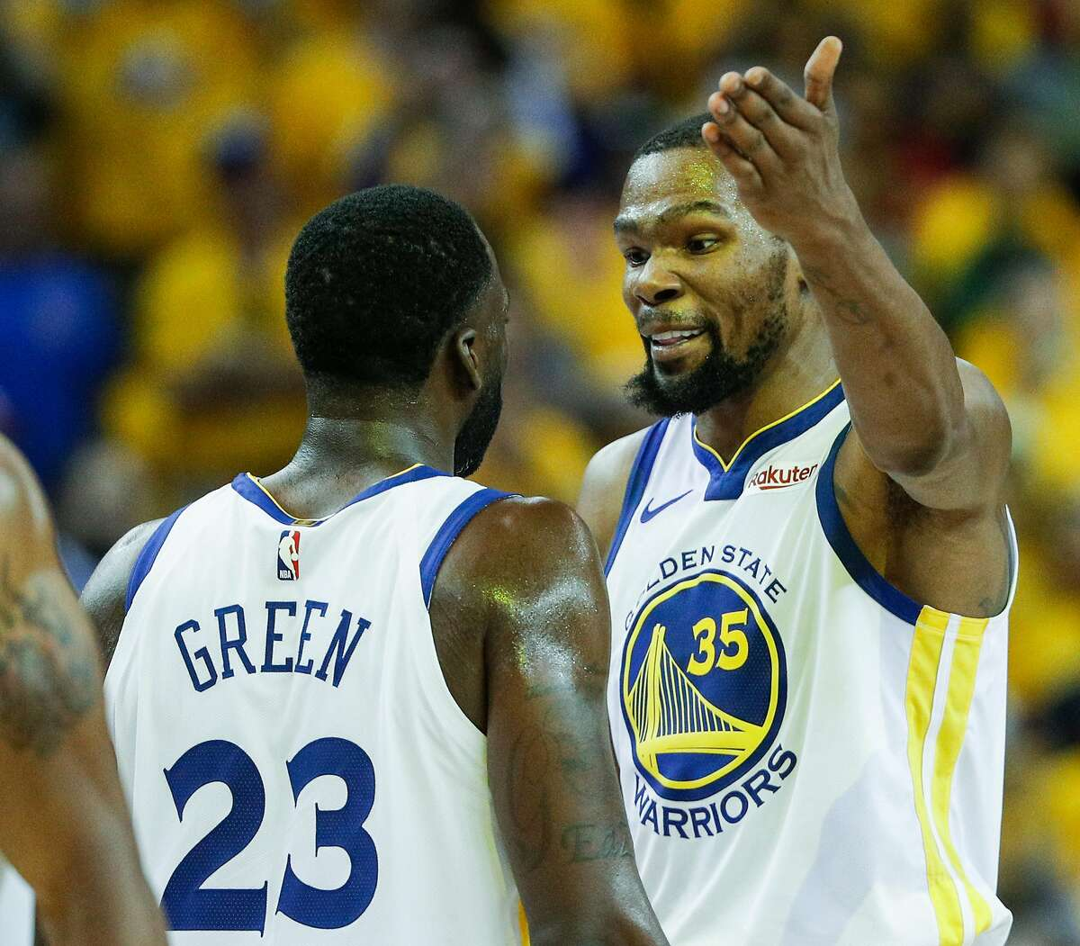 Golden State Warriors Kevin Durant and Draymond Green react after a Durant dunk in the third quarter during game 1 of the Western Conference Semifinals between the Golden State Warriors and the Houston Rockets at Oracle Arena on Sunday, April 28, 2019 in Oakland, Calif.