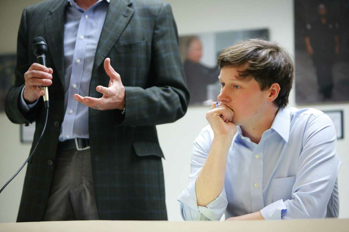 District 7 candidate Andrew Lewis, right, sits as Jim Pugel, left, speaks during a candidate forum hosted by the King County Young Democrats. Lewis is gaining labor support. Puget has won a dual endorsement from the political arm of the Seattle Metropolitan Chamber of Commerce.
