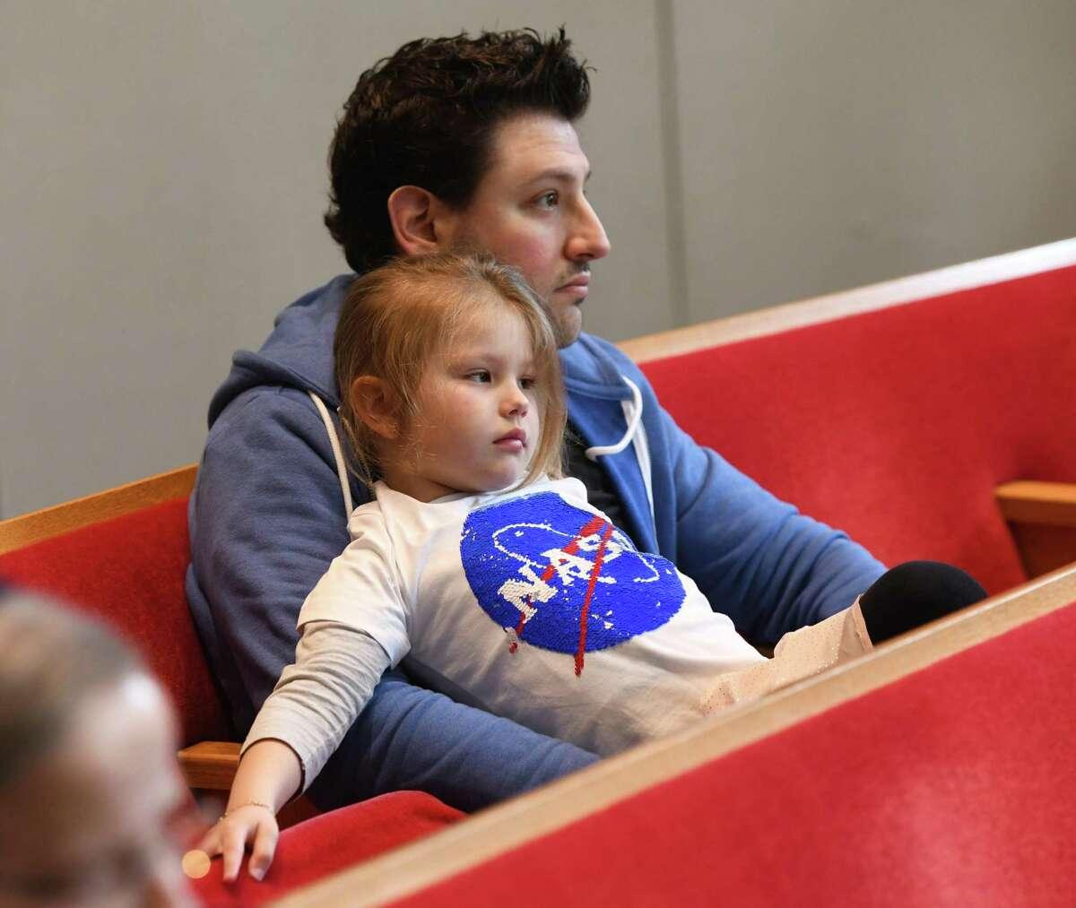 Greenwich's Marlowe Harris, 4, wears a NASA shirt beside her father, Seth Harris, while attending astronaut Dr. Jeffrey Hoffman's presentation