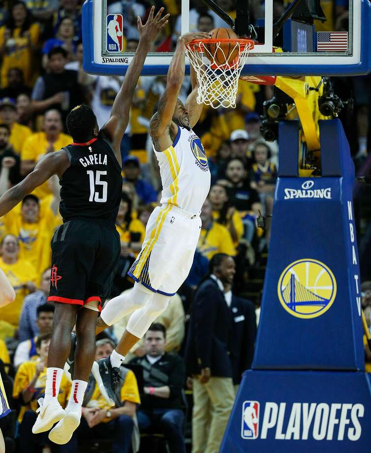 1823394cc77 Golden State Warriors Andre Iguodala dunks against Houston Rockets Clint  Capela in the fourth quarter during