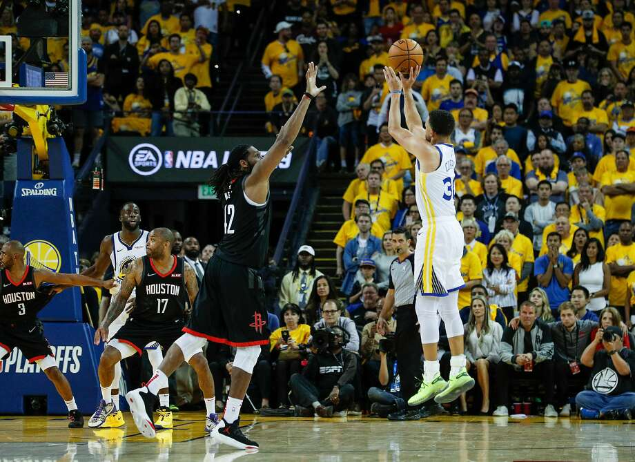 Stephen Curry shoots a 3-pointer over Houston Rockets center Nene. Photo: Carlos Avila Gonzalez / The Chronicle