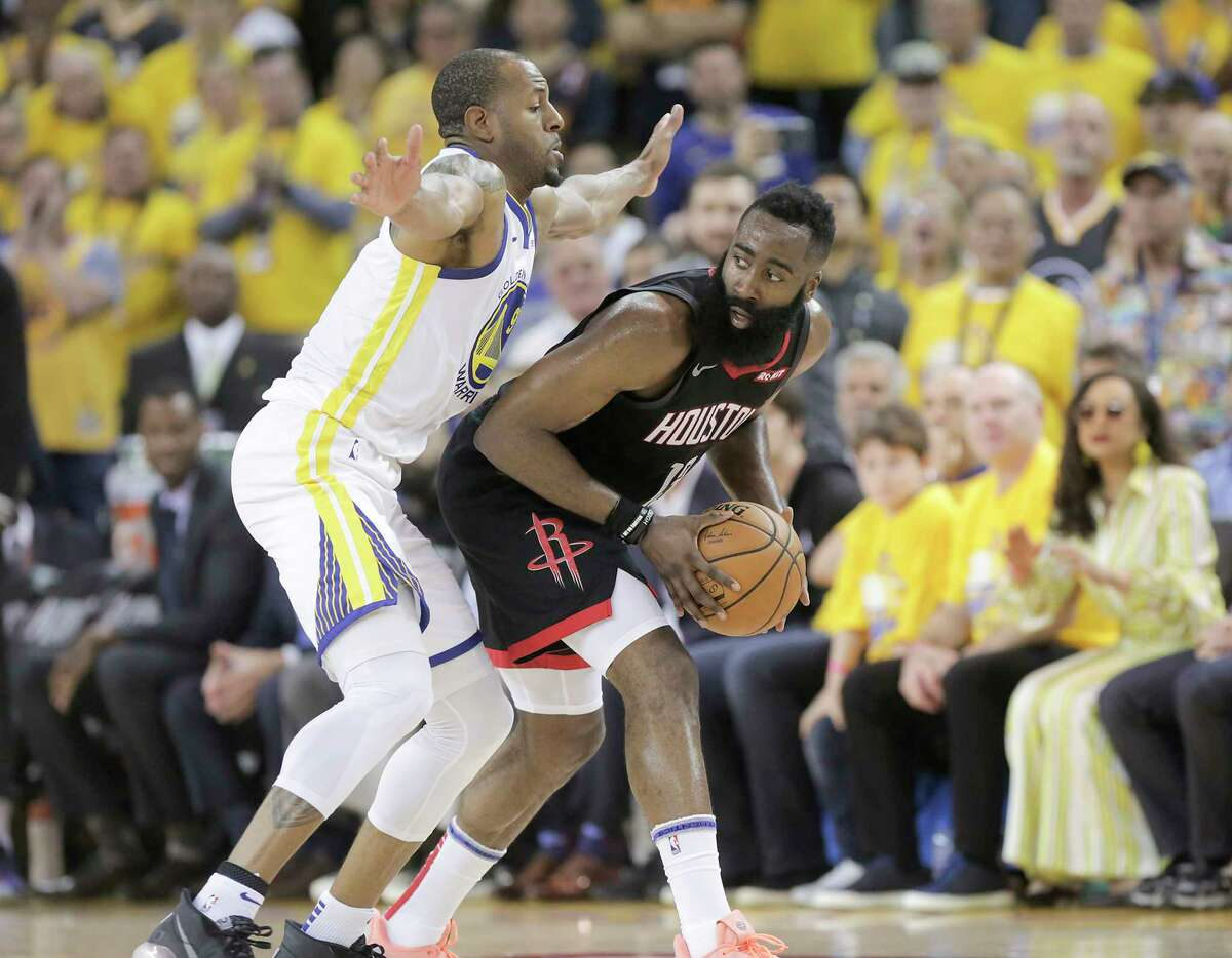 Houston Rockets guard James Harden (13) looks for a teammate to pass to as Golden State Warriors guard Andre Iguodala (9) plays defense in the second half of Game 1 of the NBA playoffs at the Oracle Arena on Sunday, April 28, 2019 in Oakland. Golden State Warriors won the game 104-100.