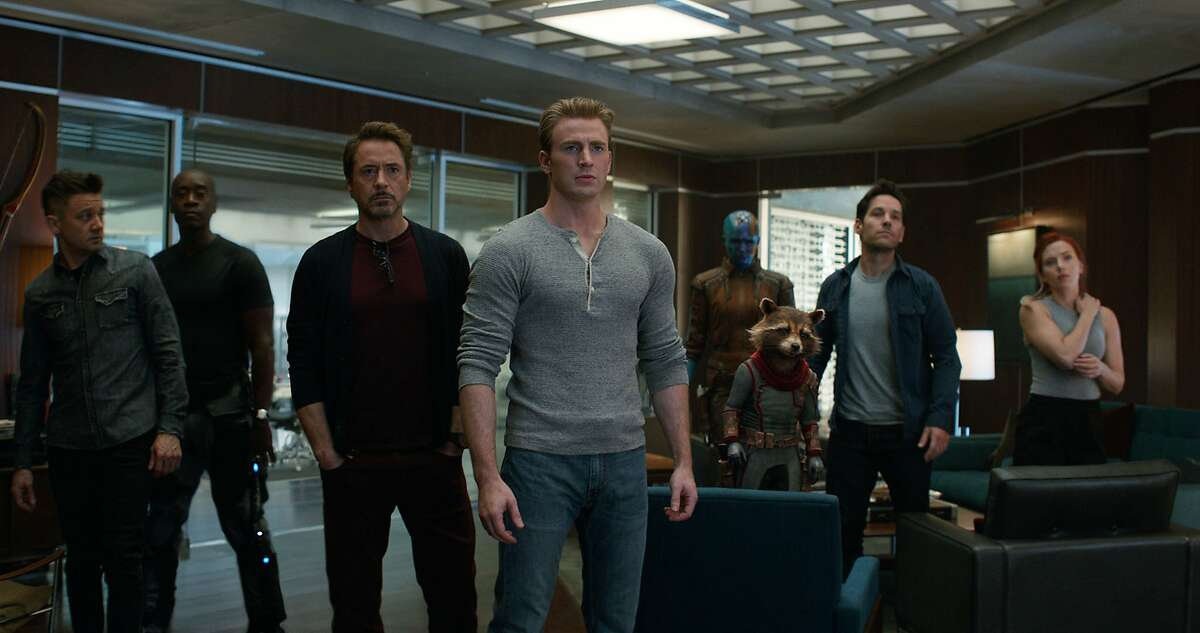 This image released by Disney shows, from left, Jeremy Renner, Don Cheadle, Robert Downey Jr., Chris Evans, Karen Gillan, the character Rocket, voiced by Bradley Cooper, Paul Rudd and Scarlett Johansson in a scene from