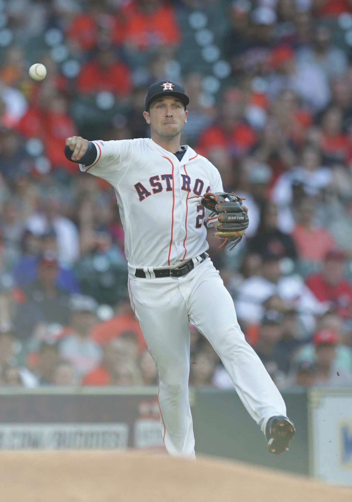 Houston Astros third baseman Alex Bregman (2) throws to first to get out Cleveland Indians first baseman Carlos Santana (41) during the first inning of a major league baseball game at Minute Maid Park Sunday, April 28, 2019, in Houston.