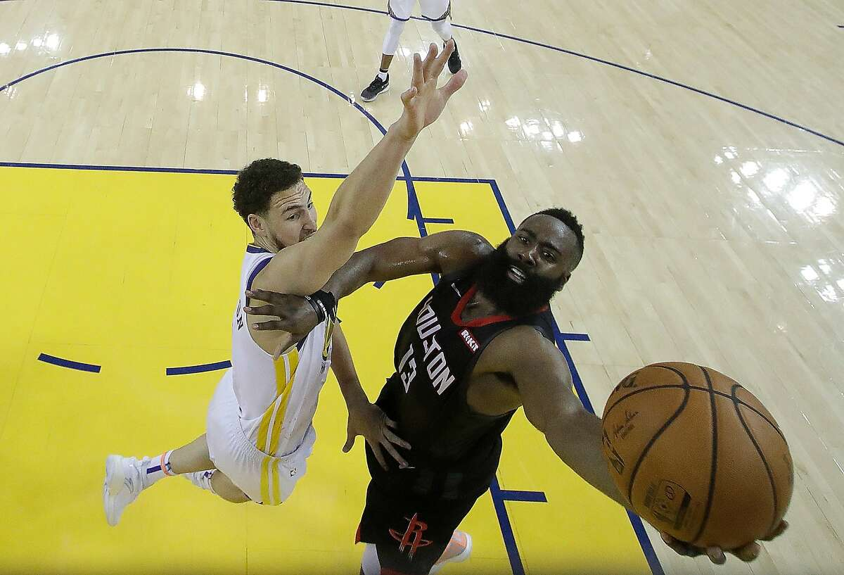 OAKLAND, CA - APRIL 28: James Harden #13 of the Houston Rockets shoots over Klay Thompson #11 of the Golden State Warriors during Game One of the Second Round of the 2019 NBA Western Conference Playoffs at ORACLE Arena on April 28, 2019 in Oakland, California. NOTE TO USER: User expressly acknowledges and agrees that, by downloading and or using this photograph, User is consenting to the terms and conditions of the Getty Images License Agreement. (Photo by Jeff Chiu/via AP Pool/Getty Images)
