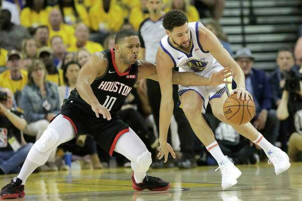 Houston Rockets guard Eric Gordon (10) goes for the ball against Golden State Warriors guard Jacob Evans (10) in the first half of Game 1 of the NBA playoffs at the Oracle Arena on Sunday, April 28, 2019 in Oakland.