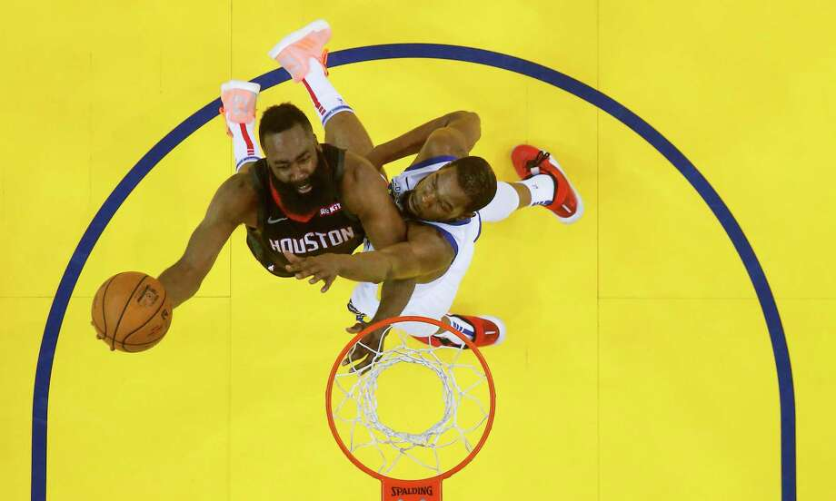 b9d6ea28cc33 Houston Rockets guard James Harden (13) puts up the ball around Golden  State Warriors