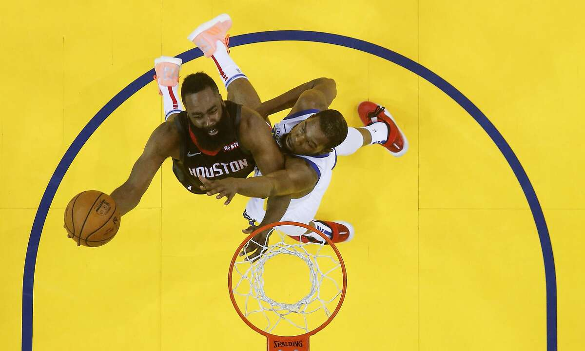 Houston Rockets guard James Harden (13) puts up the ball around Golden State Warriors forward Kevin Durant (35) during Game 1 of the NBA playoffs at the Oracle Arena on Sunday, April 28, 2019 in Oakland. Golden State Warriors won the game 104-100.